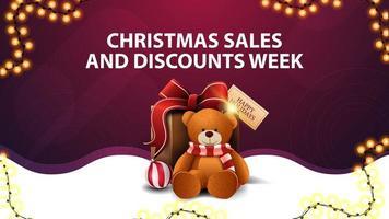 settimana di saldi e sconti natalizi, striscione sconto bianco e viola con ghirlanda, linea ondulata e regalo con orsacchiotto vettore