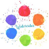 Macchie di pittura ad acquerello di colori arcobaleno vettore
