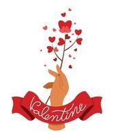 mano tiene un fiore cuore con nastro con testo di San Valentino.