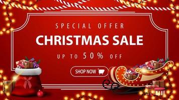 offerta speciale, saldi natalizi, sconti fino a 50, striscione rosso moderno con cornice vintage, ghirlande, borsa di Babbo Natale e slitta di Babbo Natale con regali vettore