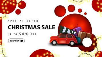 banner sconto moderno, offerta speciale, saldi natalizi, fino a 50 di sconto. banner di sconto con un design moderno con cerchi rossi e auto d'epoca rossa che trasportano albero di Natale vettore