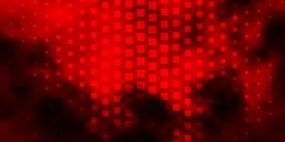 sfondo vettoriale arancione scuro in stile poligonale.