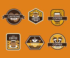Vettore dei distintivi del caffè