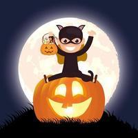 scena oscura di Halloween con zucca e bambino in costume da gatto
