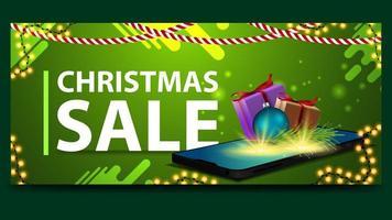 banner sconto verde di Natale con lo smartphone vettore
