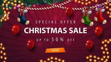 modello di vendita di natale rosso con ghirlanda, palloncini e calze natalizie vettore