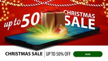 vendita di natale, fino a 50 di sconto, banner sconto rosso per sito Web con smartphone