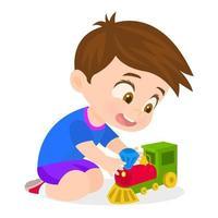 bambino che gioca con la ferrovia giocattolo vettore