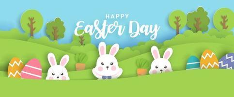 carta del giorno di Pasqua con conigli carini e uova di Pasqua. vettore