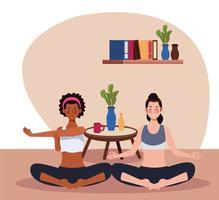 donne interrazziali che praticano yoga in casa