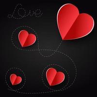 sfondo di San Valentino. cuori rossi papaer carta tagliata su sfondo nero.