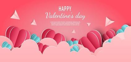 sfondo di San Valentino. cuori rosa e blu carta tagliata carta su sfondo rosa. nuvole di decorazioni e aereo con spazio per il testo.
