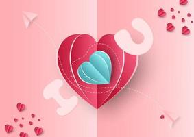 sfondo di San Valentino. cuori rosa e blu carta tagliata carta su sfondo blu. piano di arredamento con spazio per il testo.