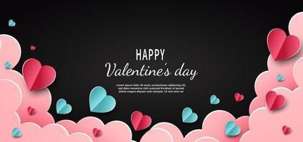 sfondo di San Valentino. cuori rosa e blu carta tagliata carta su sfondo nero. decor nuvole spazio per il testo.