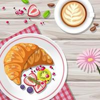 vista dall'alto di croissant con una tazza di caffè sul tavolo vettore