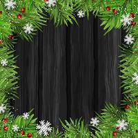Filiali dell'albero di Natale su fondo di legno vettore