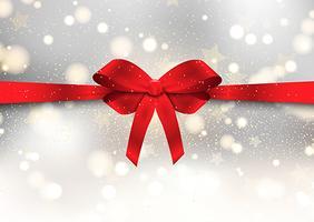 Sfondo di Natale con fiocco rosso lucido vettore