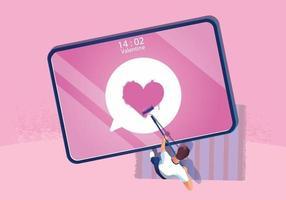 un uomo dipinge il simbolo del cuore sul tablet sullo schermo concetto di San Valentino, sito Web o applicazione per telefono cellulare e marketing digitale. lo smartphone di promozione del messaggio, design piatto vettoriale vista dall'alto