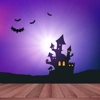 Tavolo in legno che si affaccia su un paesaggio di Halloween vettore