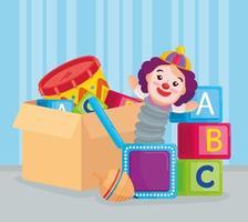 cubi di alfabeto e giocattoli per bambini in una scatola vettore