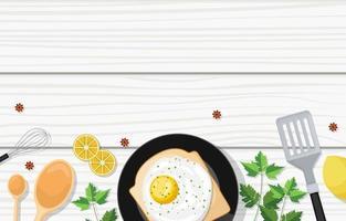 uova su pane tostato con utensili da cucina sulla tavola di legno vettore