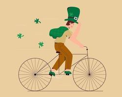 giorno di San Patrizio con l'uomo in bicicletta vettore