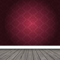 Stanza vuota con carta da parati damascata e pavimento in legno
