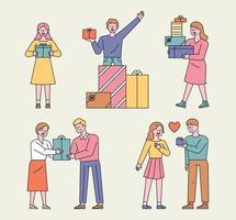 persone con scatole regalo. le persone stanno impilando scatole regalo e sono felici e fanno regali ai propri cari.