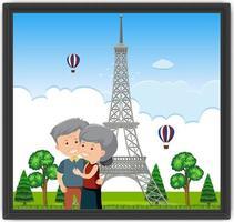 una foto di una vecchia coppia con la torre eiffel vettore