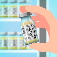 una mano destra che tiene una bottiglia del vaccino contro il coronavirus di nuova concezione, covid-19 per prevenire la diffusione del virus che si sta diffondendo in tutto il mondo vettore