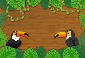 banner vuoto con cornice di foglie tropicali e personaggio dei cartoni animati tucano vettore