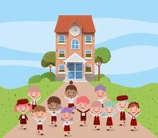 edificio scolastico con bambini interrazziali