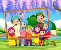 famiglia felice che tiene cornice per foto con moschea sullo sfondo vettore