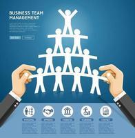 progettazione concettuale della gestione del team aziendale. mano che tiene una squadra di persone tagliate di carta. illustrazioni vettoriali. vettore