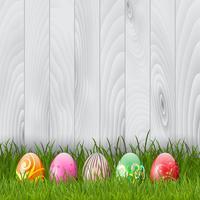 Uova di Pasqua su una priorità bassa di legno vettore