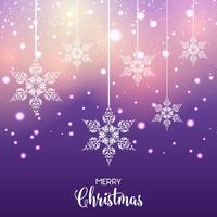 Appesi fiocchi di neve decorativi di Natale vettore