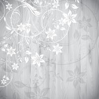 Disegno floreale su fondo di legno vettore