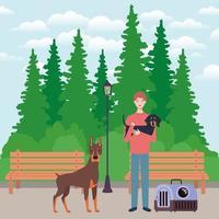 giovane con simpatici cani mascotte nel parco vettore
