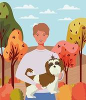 giovane con mascotte cane carino nel campo autunnale vettore