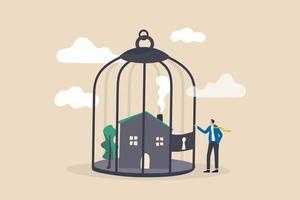 problema di pagamento ipotecario, debito immobiliare nel concetto di crisi economica, imprenditore preoccupato proprietario di casa in piedi con la sua casa all'interno della gabbia per uccelli chiusa a chiave. vettore