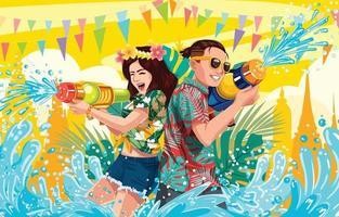coppia che gioca pistola ad acqua nel festival di songkran vettore