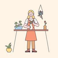 donna che fa giardinaggio domestico sul tavolo vettore