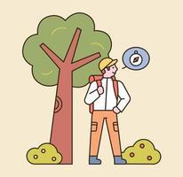 un uomo sta viaggiando con lo zaino. sta cercando indicazioni sotto l'albero. illustrazione di vettore minimo di stile di design piatto.