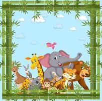 gruppo di animali selvatici con cornice di bambù vettore
