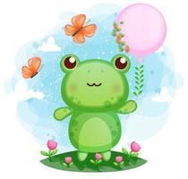 piccola rana carina che tiene un palloncino vettore