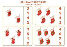 gioco di conteggio con calzini di Natale dei cartoni animati. gioco di matematica. vettore