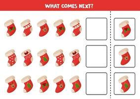 cosa viene dopo il gioco logico. set di calzini di Natale dei cartoni animati. vettore