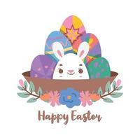 uova di Pasqua dipinte in un cesto con un simpatico coniglietto nel mezzo vettore