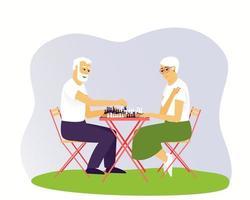 uomo e donna anziani stanno giocando a scacchi vettore