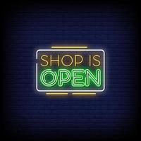 il negozio è il vettore di testo in stile insegne al neon aperte